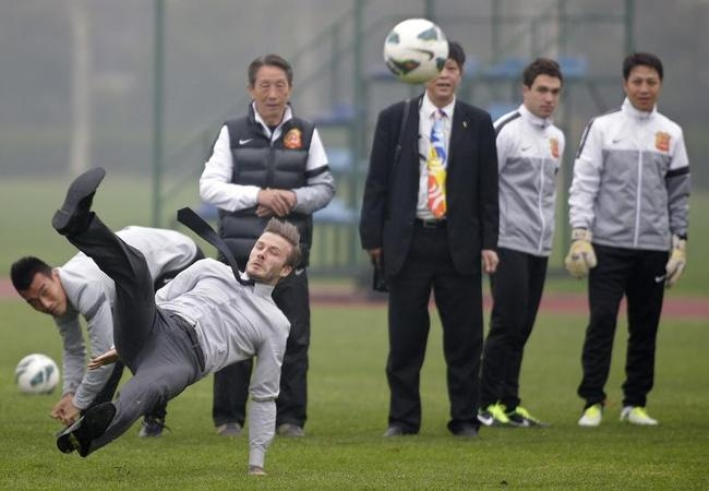 David Beckham Lands on His Butt in China