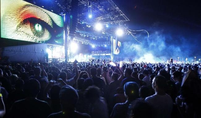 "Concert-goers watch the performance of ""Tiesto"" at the Coachella Music Festival in Indio"