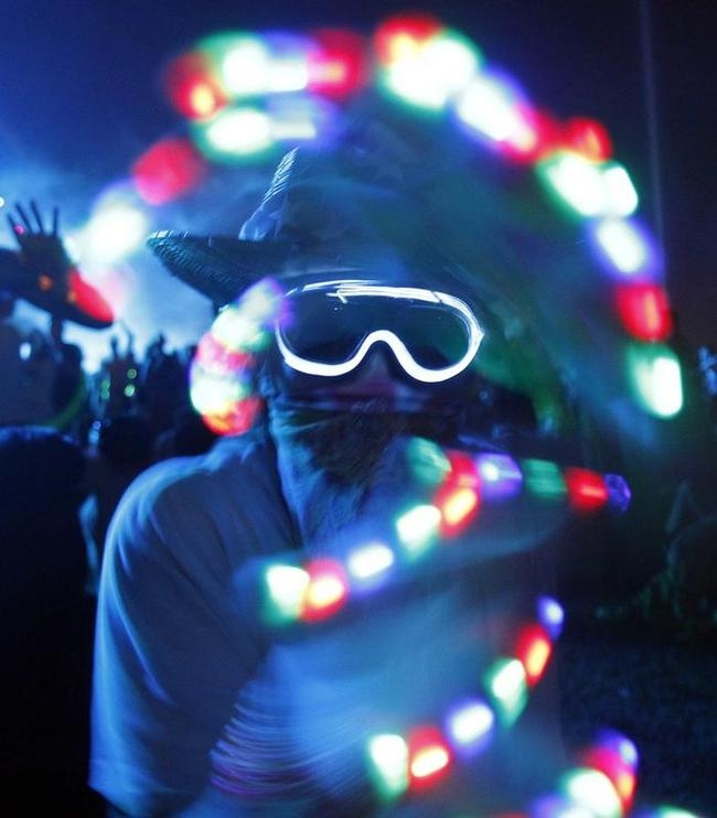 "A concert-goer dances during the performance by ""Tiesto"" at the Coachella Music Festival in Indio"