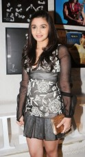 In a black Shehlaa Khan dress