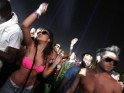 "Concert-goers dance during the performance by ""Tiesto"" at the Coachella Music Festival in Indio"