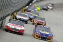 Cars race during the NASCAR Sprint Cup Series Food City 500 at Bristol Motor Speedway