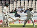 MS Dhoni takes the catch to dismiss Phillip Hughes