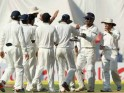 Team India celebrates the wicket of Michael Clarke