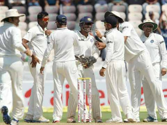 R Ashwin celebrates the wicket of Phillip Hughes