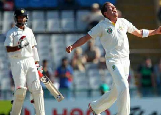Peter Siddle celebrates the wicket of Cheteshwar Pujara