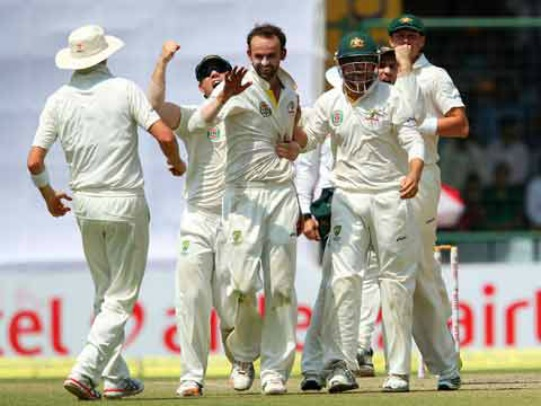 Nathan Lyon celebrates the wicket of Virat Kohli
