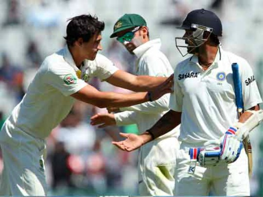 Mitchell Starc congratulates Murali Vijay on his innings