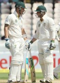 Phillip Hughes and Michael Clarke in action