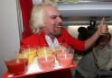 """""""Stewardess"""" Richard Branson Serves Passengers On AirAsia Flight"""