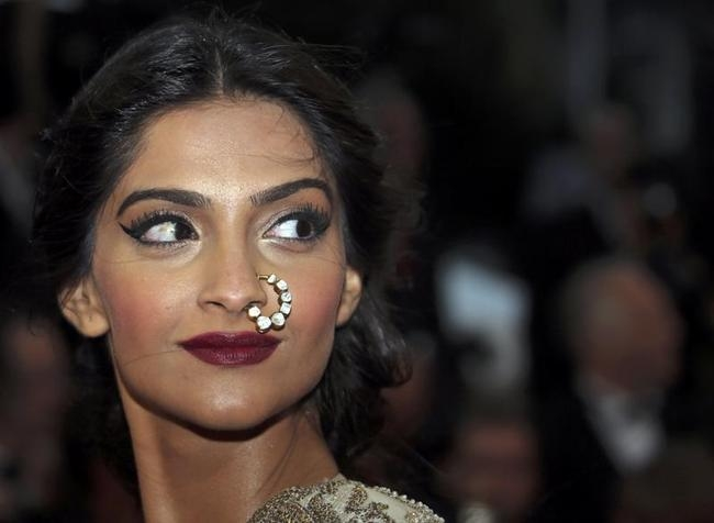 Bollywood actress Sonam Kapoor poses on the red carpet as she arrives for the screening of the film