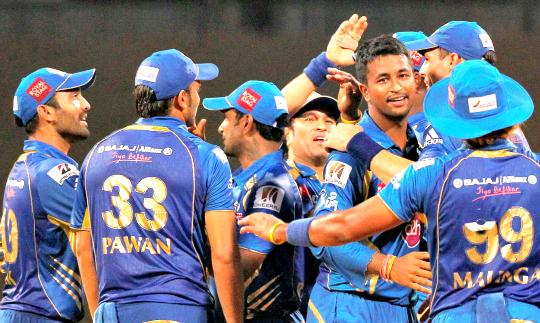 Mumbai Indians celebrate their win over Chennai Super King during IPL 6 in Mumbai on Sunday.