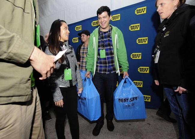 A Xbox fan leaves after being one of the first to receive their new Xbox One after midnight during the Xbox One fan celebration and launch party in Los Angeles