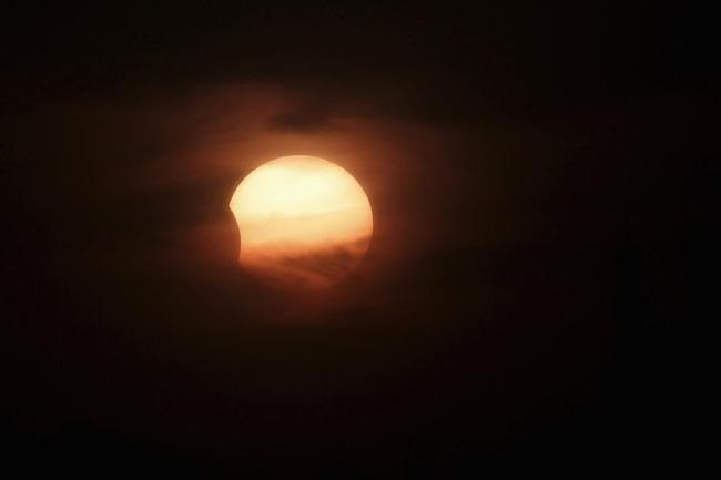 A partially-eclipsed sun is seen in Amman