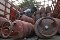 Worker loads empty Liquefied Petroleum Gas cylinders onto a supply truck in the southern Indian city of Chennai