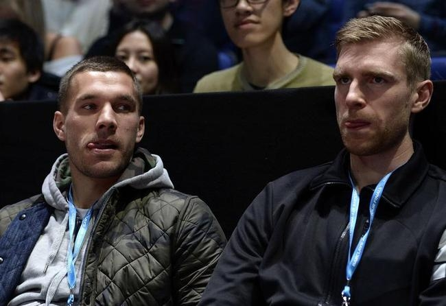 Lukas Podolski and Per Mertesacker