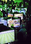 Xbox fans play the latest games during the Xbox One fan celebration and launch party in Los Angeles, California