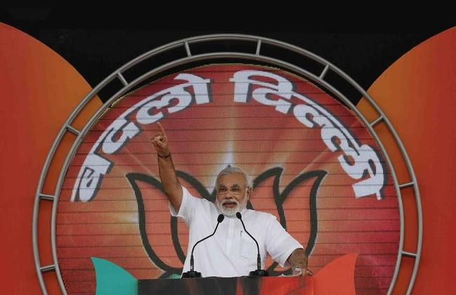 Hindu nationalist Modi addresses his party supporters during a rally in New Delhi
