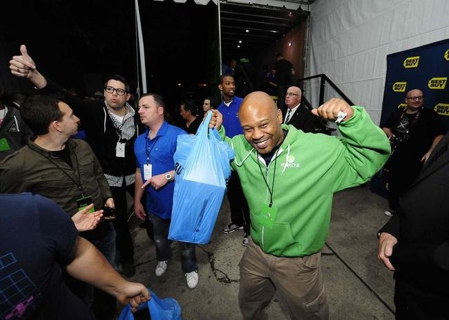 A Xbox fan celebrates after receiving his new Xbox One after midnight during the Xbox One fan celebration and launch party in Los Angeles, California