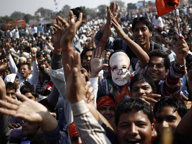 A supporter wearing a mask Hindu nationalist Modi, prime ministerial candidate for India
