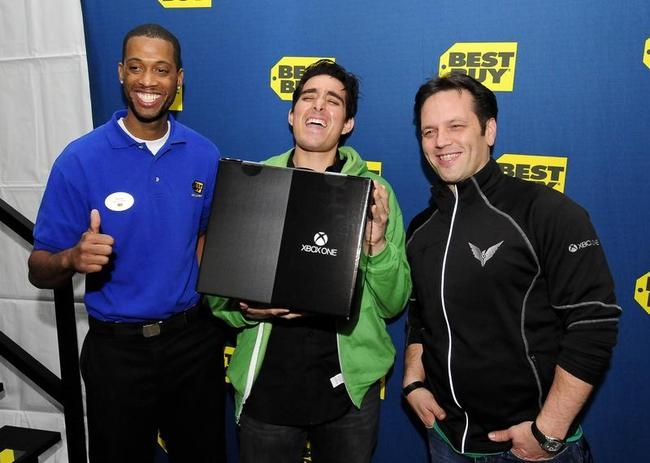 La Mar and Spencer present Anthony with the first Xbox One console during the Xbox One fan celebration and launch party in Los Angeles