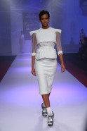 Bora's show at the Signature International Fashion Weekend 2013 opened with six white creations where the quilted detailing appeared on a variety of segments on the pencil skirts, cropped jackets, chiffon tiered trapeze dresses, peplum blouses teamed wi