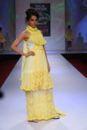 Kangana wore a yellow chiffon layered gown edged with crochet, knit and woven patches and long sheer trails giving a dramatic touch to the creation.
