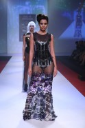 Miss Asia Pacific World 2013 Shristi Rana followed in a sheer lean long gown with glittering sequins.