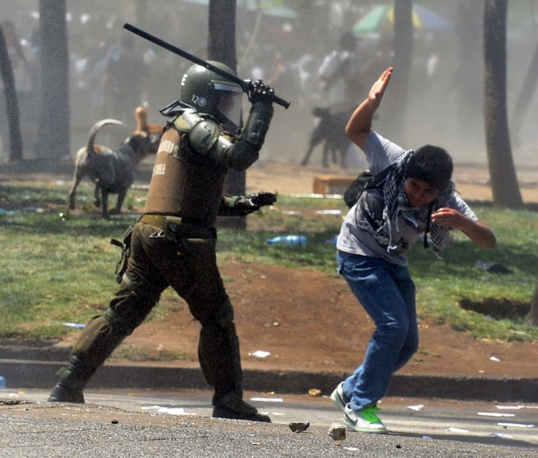 Students clash with riot police