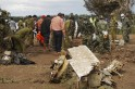 Rescue personnel work at the crash site of an ATR-72 turboprop plane, in Laos, near Pakse
