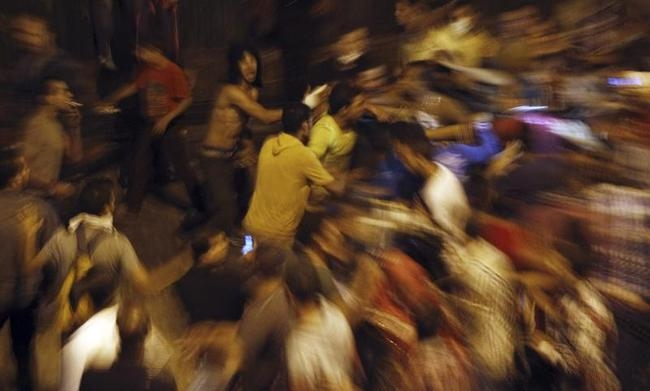 Anti-Mursi protesters clash with members of the Muslim Brotherhood and supporters of ousted Egyptian President Mohamed Mursi in Cairo