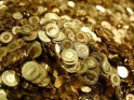 Swiss Francs five cent coins are heaped in a pile in the old vault of the former Schweizerische Volksbank in Basel