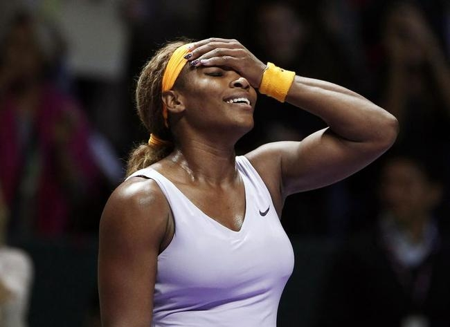 Williams of the U.S. celebrates after her victory against Li Na of China after their WTA tennis championships