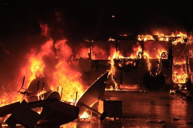 A bus burns after demonstrators from the group Black Bloc set fire to it during a protest in Rio de Janeiro