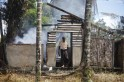 A man walks out from a destroyed mosque that was burnt down in recent violence at Thapyuchai village