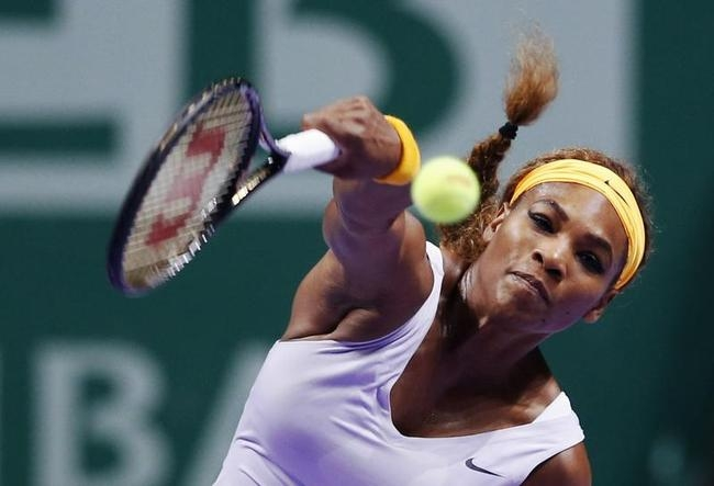 Williams of the U.S. hits a return to Li of China during their WTA tennis championships final match, in Istanbul