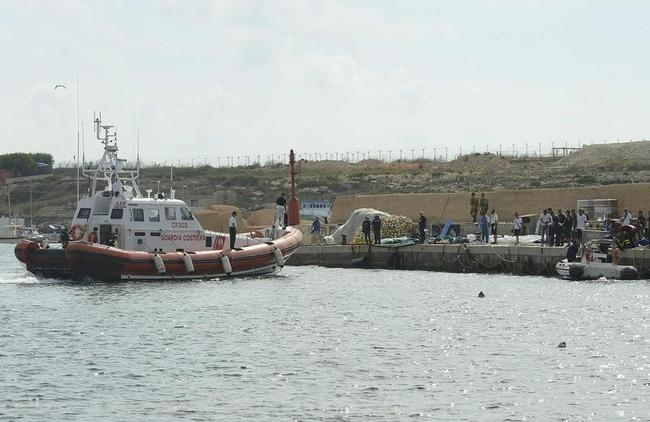 Body bags containing African migrants, who drowned trying to reach Italian shores, lie in the harbour of Lampedusa
