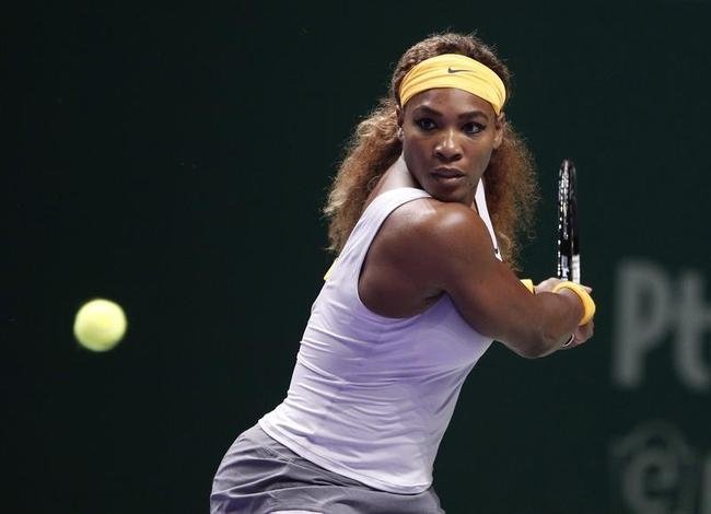 Williams of the U.S. hits a return to Na of China during their WTA tennis championships final match