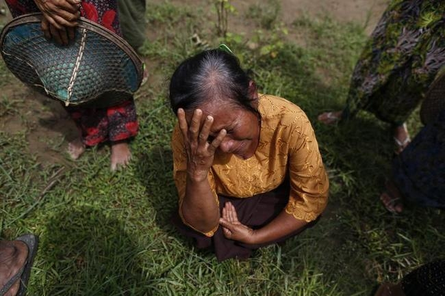 A Muslim woman, whose home was burnt down during recent violence, cries in Pauktaw village, outside of Thandwe in the Rakhine state