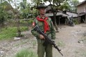 A soldier stands guard near Muslim homes at Shwe Lay village