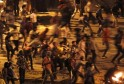 Protesters throw stones during a clash between supporters and opponents of ousted Egyptian President Mursi, at Ramsis square in Cairo