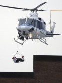 A helicopter pulls what appears to be a shooting victim up as it hovers over a rooftop on the Washington Navy Yard campus in Washington