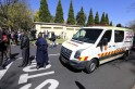 Members of the South African police stand guard near an ambulance that was escorting another which was believed to be carrying Mandela, outside his house in Houghton, Johannesburg