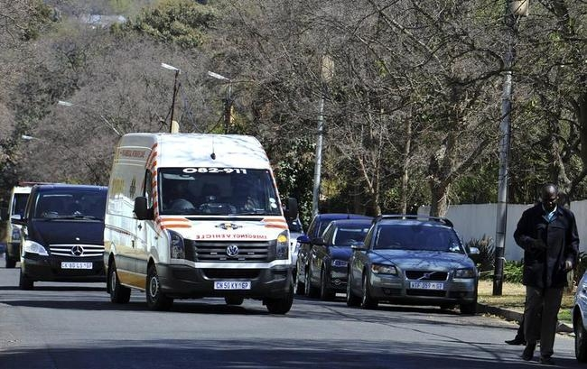 An ambulance, believed to be carrying former South African President Nelson Mandela, arrives at his house in Houghton, Johannesburg