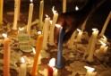 """Members of civil society placed candles in front of an """"I"""