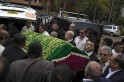 Relatives carry a coffin during the funeral procession for Selima Merali and her daughter Nuriana Merali, who were killed in the attack by gunmen at the Westgate Shopping Centre in Nairobi