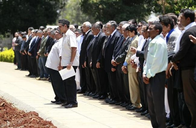 Relatives and friends perform final prayers during the burial of Kenyan journalist Sood, who was killed in the Westgate shopping mall attack, in Nairobi