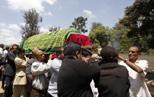 Relatives and friends carry the coffin of Kenyan journalist Sood, who was killed in the Westgate shopping mall attack, during her funeral in Nairobi