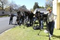 Members of the media stand outside former South African President Mandela