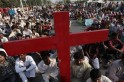 Members of the Pakistani Christian community attend a protest rally to condemn Sunday